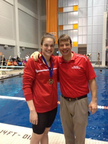 Kristen Vredeveld and Dan Flack pose after being named Swimmer and Coach of the Meet at the Tennessee HS State Championship.