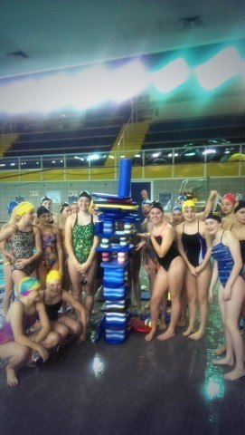 Lyons Swimming went for style AND height points on their Festivus pole. Jenga, anybody?