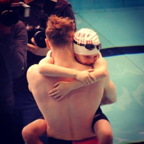 Lewis Coleman and his little brother hug at Swim4Leukemia fundraiser Courtesy: Lewis Coleman