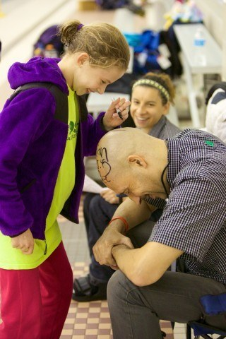 If a swimmer from Sea Devil Swimming broke a team record or won a championship heat, they were able to write on their head coach's head.