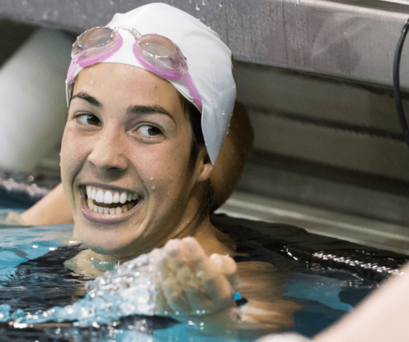 Maya DiRado is all smiles afer her 400 IM win (plus 200 IM win from day 1) at the 2014 NCAA Women's DI Swimming & Diving Championships (Tim Binning, theswimpictures)
