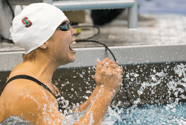 Felicia Lee roars in victory after her 100 butterfly win at the 2014 NCAA Women's DI Swimming & Diving Championships (Tim Binning, theswimpictures)