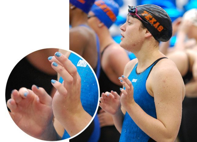 Lily Moldenhauer has opted to match her blue Arena suit rather than her black and orange Texas cap.