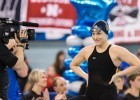 Emma Reaney of Notre Dame, seeded first in the 200 breaststroke final takes it in stride as the ESPN camera records her every move before the start of the race at the 2014 Women's NCAA DI Swimming & Diving Championships (courtesy of Tim Binning, the swim pictures)
