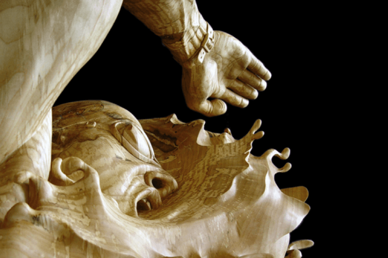 Beautiful Swimming Sculpture Carved From One Piece of Wood