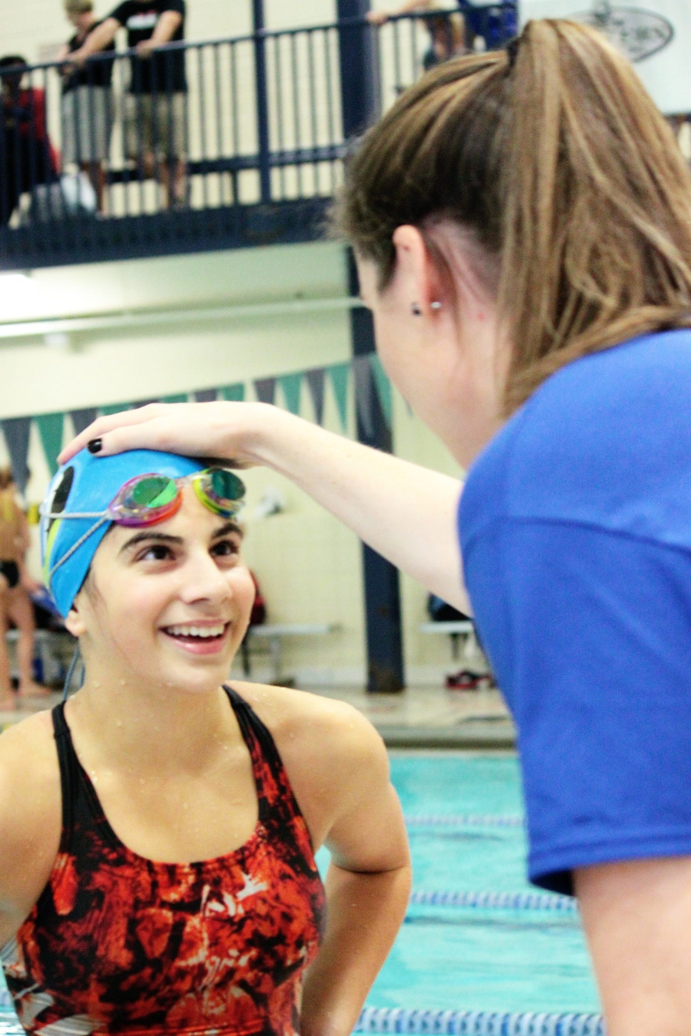 Kara lynn joyce gives feedback to a particpant fitter and faster