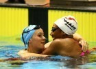 Hawkes Bay 15 year old Bobbi Gichard (left) is congratulated by Gabrielle Fa'amausili after the 100m backstroke.