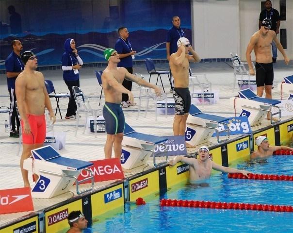 Cameron Van der Burgh, Daniel Gyurta, Michael Andrew preparing to race