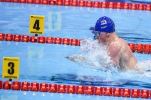 Peaty cruises to victory in men's 100 breast.